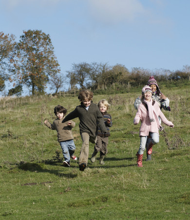 pursued: Children running in countryside LANG_EVOIMAGES