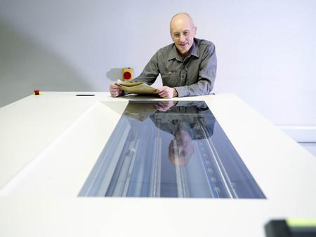 Worker Inspecting Printer LANG_EVOIMAGES
