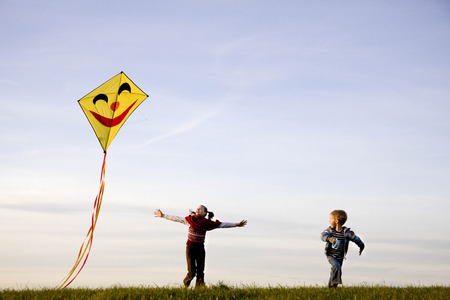 pursuing: Girl and Boy fly a Kite