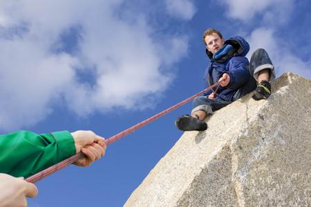 Climber belaying fellow climber LANG_EVOIMAGES