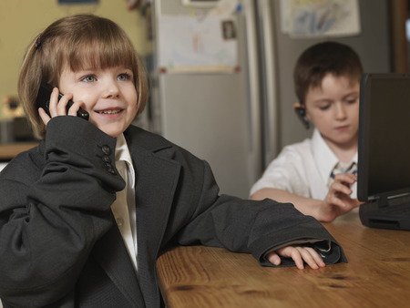 oversized: children dressed as business people