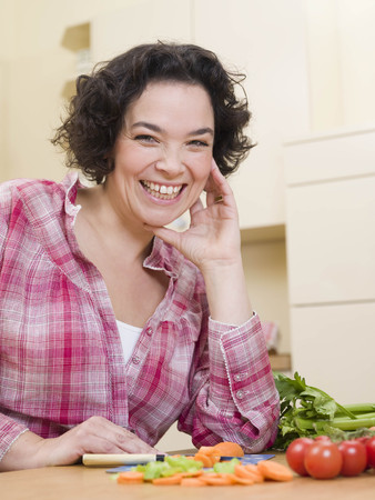 worktops: woman cutting vegetables