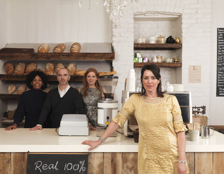 new age: Business owner posing with employees