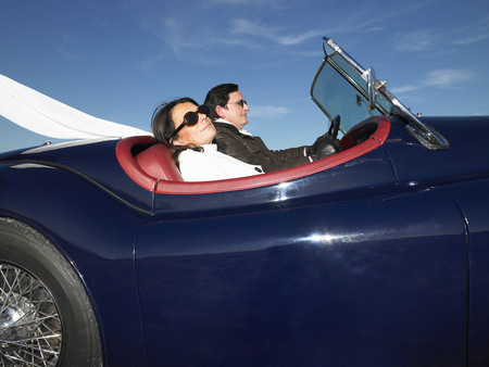 lavishly: Couple in an old convertible