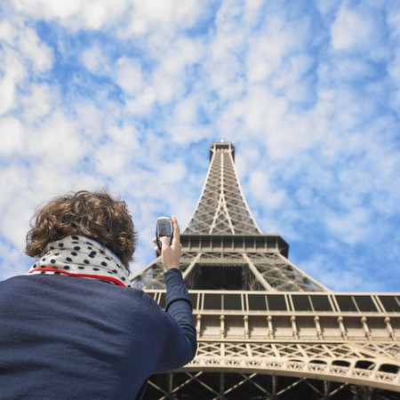 histories: Man taking picture of Eiffel tower