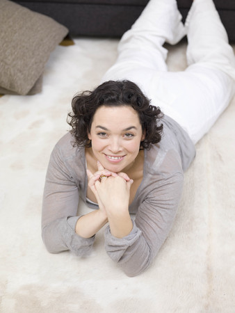 One woman relaxing on the floor.