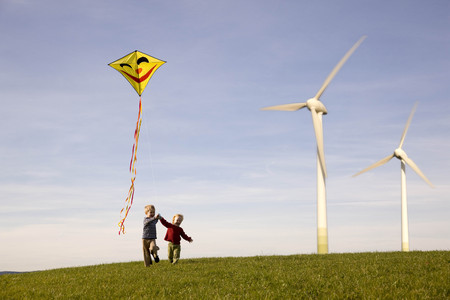 conscience: Two Boys Flying Kite at Wind Turbines
