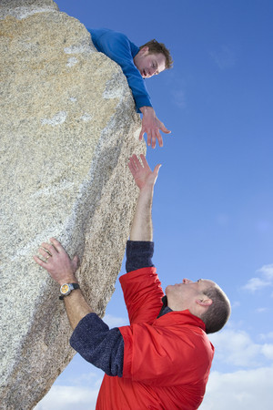 Climber offering hand to fellow climber