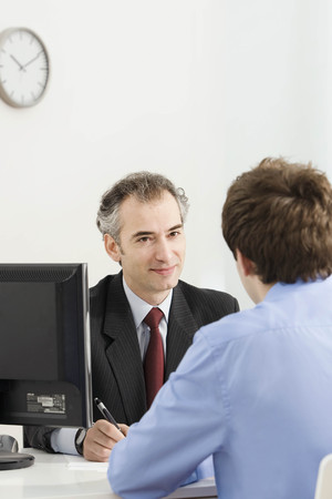 english ethnicity: A latin business manager with a customer