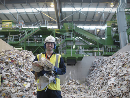 protects: Worker With Paper Being Recycled