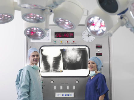 power operated: Surgeon and nurse with x-rays LANG_EVOIMAGES