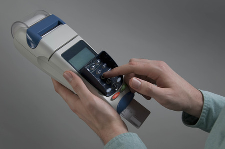 appendage: Male holding credit card machine