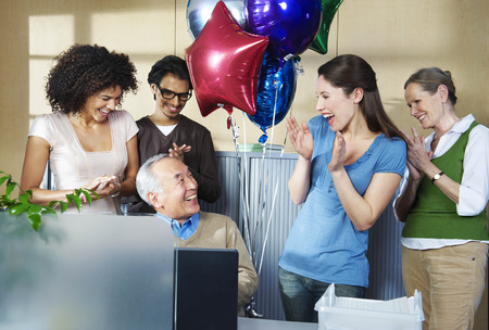 rooting: Group of office workers celebrating