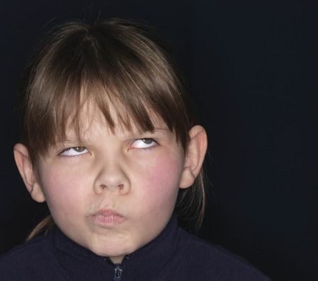 Girl making a grimace, close-up
