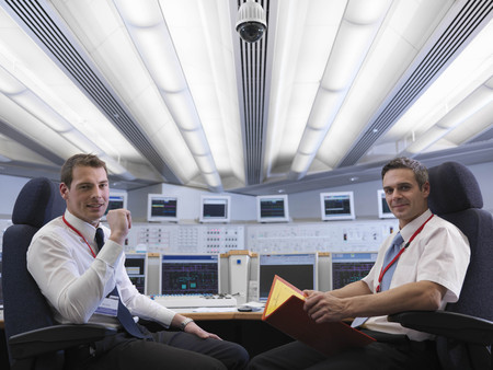 liable: Operators seated in control room LANG_EVOIMAGES