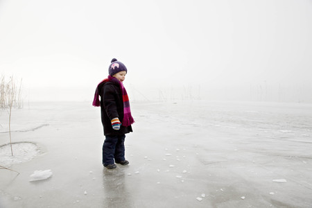 jeopardizing: boy on frozen lake in the fog