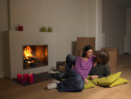 blazes: Couple with moving boxes, fire place
