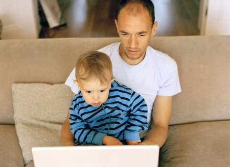 Father, Son looking at laptop