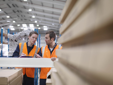 Workers Inspecting Product In Warehouse LANG_EVOIMAGES