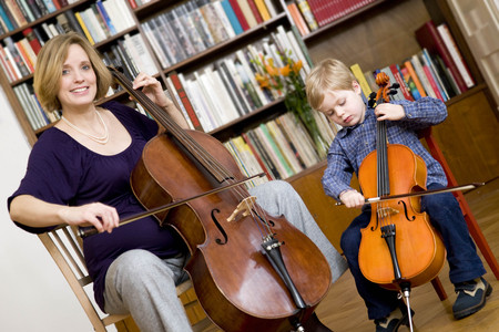 pregnant woman and boy playing Cello LANG_EVOIMAGES