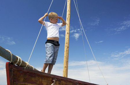 survives: Boy on sailing boat LANG_EVOIMAGES