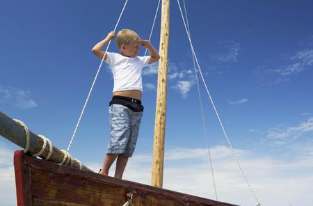Boy on sailing boat LANG_EVOIMAGES