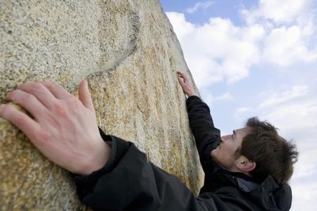 rockclimber: climber free climbing boulder LANG_EVOIMAGES