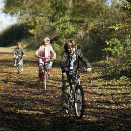 pursued: Children riding bikes in countryside