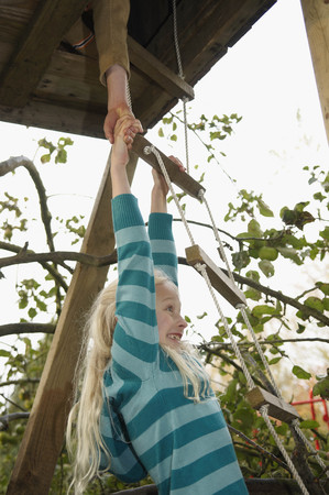 scaling ladder: Boy helping girl to treehouse LANG_EVOIMAGES