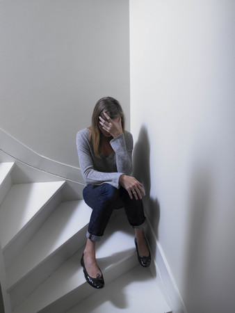 cried: Woman sitting on stairs