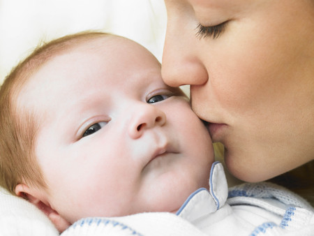 Mother kissing her baby LANG_EVOIMAGES