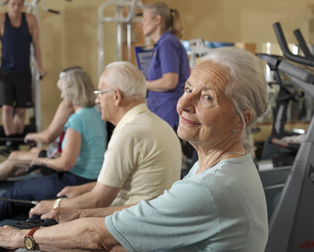 seniors training at gym with instructor