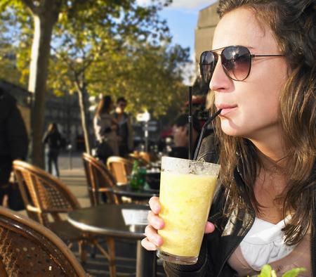 rejuvenated: Woman on terrace of café