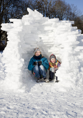 peep: Girl and boy in igloo in the snow