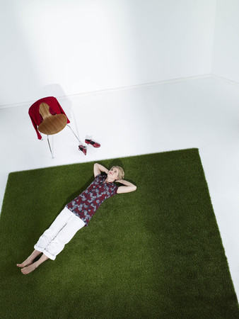weber: Woman laying down on grass