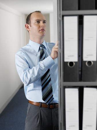 Office worker looking at files