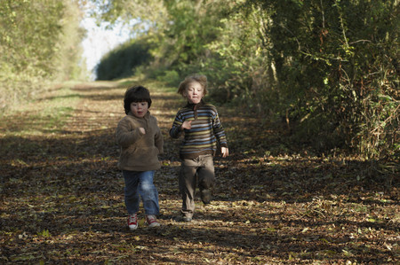 enthusiastically: Two boys racing on country lane