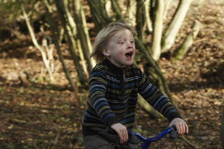 shrieking: Boy riding bike in countryside