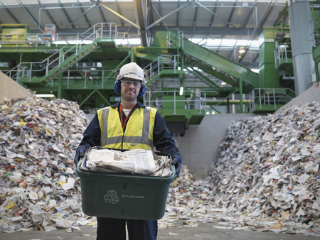 toils: Worker With Waste Recycling Box