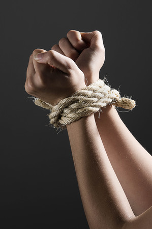 Female hands tied together