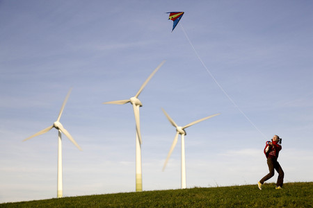 body consciousness: Girl Flying Kite at Wind Turbines