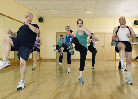 enthusiastically: aerobic exercise at gym LANG_EVOIMAGES