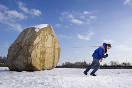 Man pulling boulder LANG_EVOIMAGES