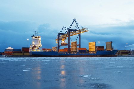 Containers on ship in harbour LANG_EVOIMAGES
