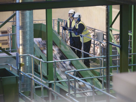 viewed: Workers Overlooking Recycle Plant LANG_EVOIMAGES