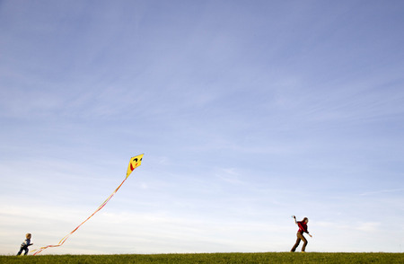 pursuing: Boy and Girl fly a Kite