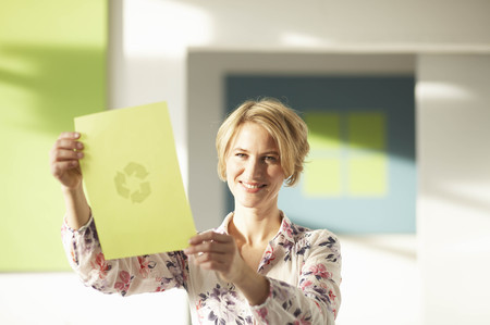 weber: Woman looking at green sheet with logo