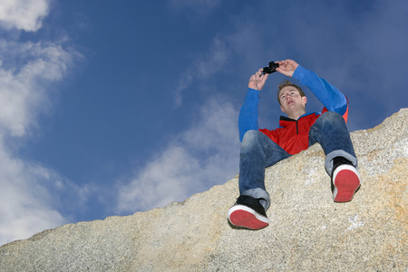 man taking picture on mountain top