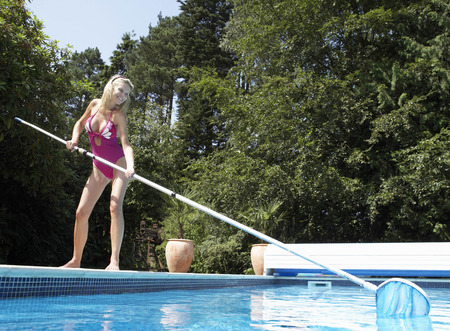 Women cleaning pool LANG_EVOIMAGES