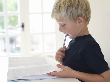 committed: Boy 7 doing homework